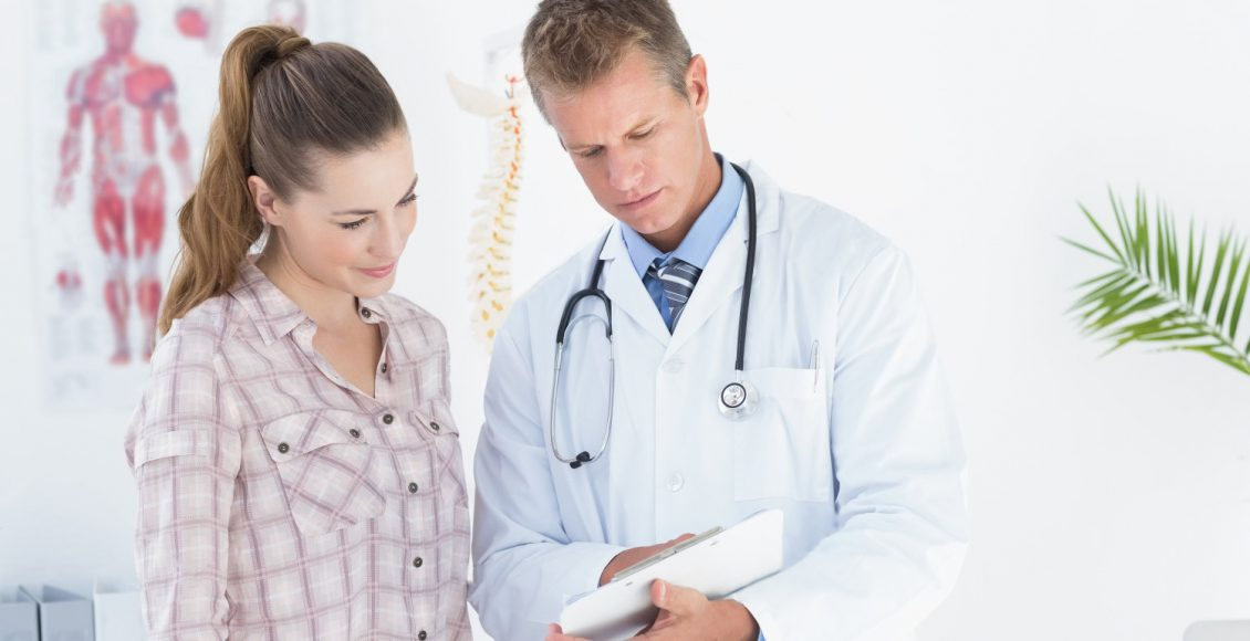 chiropractor shows patient her results