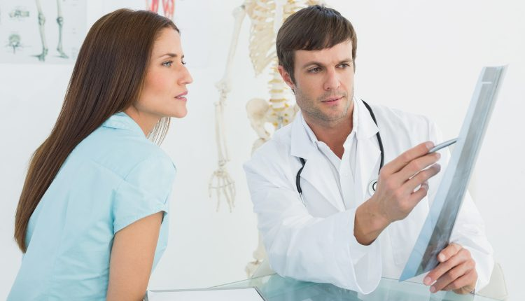 male-doctor-explaining-x-ray-to-female-patient