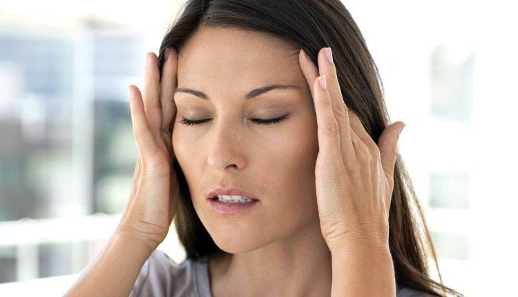 migraine lady grabbing temples_01