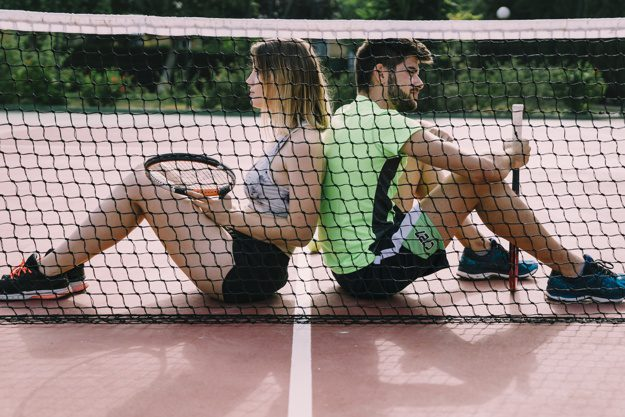 tennis elbow players sitting at the net